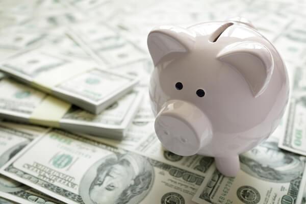bigstock-Piggy-bank-on-money-concept